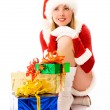 Dreamy girl with Christmas presents — Stock Photo