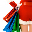 Girl dressed as Santa with Christmas presents — Stock Photo