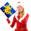 Pretty girl shaking a Christmas present — Foto Stock