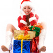 Stock Photo: Happy girl with Christmas presents