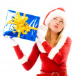Girl shaking a box with a Christmas present — Stock Photo