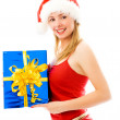 Pretty girl holding a Christmas present — Stock Photo