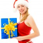 Pretty girl holding a Christmas present — Stock Photo