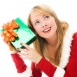 Stock Photo: Pretty girl shaking a Christmas present