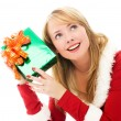 Pretty girl shaking a Christmas present — Stock Photo