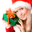 Pretty girl with a Christmas present — Stock Photo