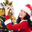 Beautiful brunette woman decorating a Christmas — Stock Photo #3191042