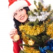 Beautiful woman decorates a Christmas tree — Stock Photo