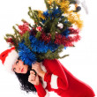 Beautiful woman carrying a Christmas tree — Stock Photo