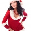 Sexy brunette woman dressed as Santa — Stock Photo
