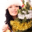 Beautiful brunette woman decorating a Christmas — Stock Photo #3191087