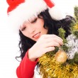 Beautiful brunette woman decorating a Christmas — Stock fotografie