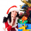 Beautiful brunette girl under the Christmas tree — Stock Photo