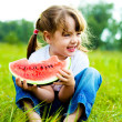 Stock Photo: Girl eating water-melon