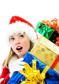 Surprised girl with a lot of Christmas presents — Stock Photo