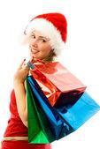 Cheerful girl with Chrismas presents — Stock Photo