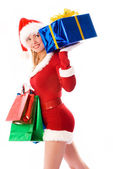 Pretty girl carrying Christmas presents — Stock Photo