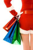 女孩打扮成圣诞老人与圣诞显示 — 图库照片