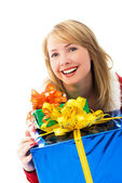 Suprised girl with a lot of presents — Stock Photo