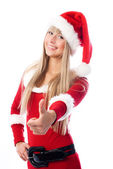Girl dressed as Santa with her thumb up — Stock Photo