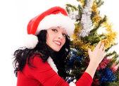 Beautiful brunette woman near the Christmas tree — Stock Photo