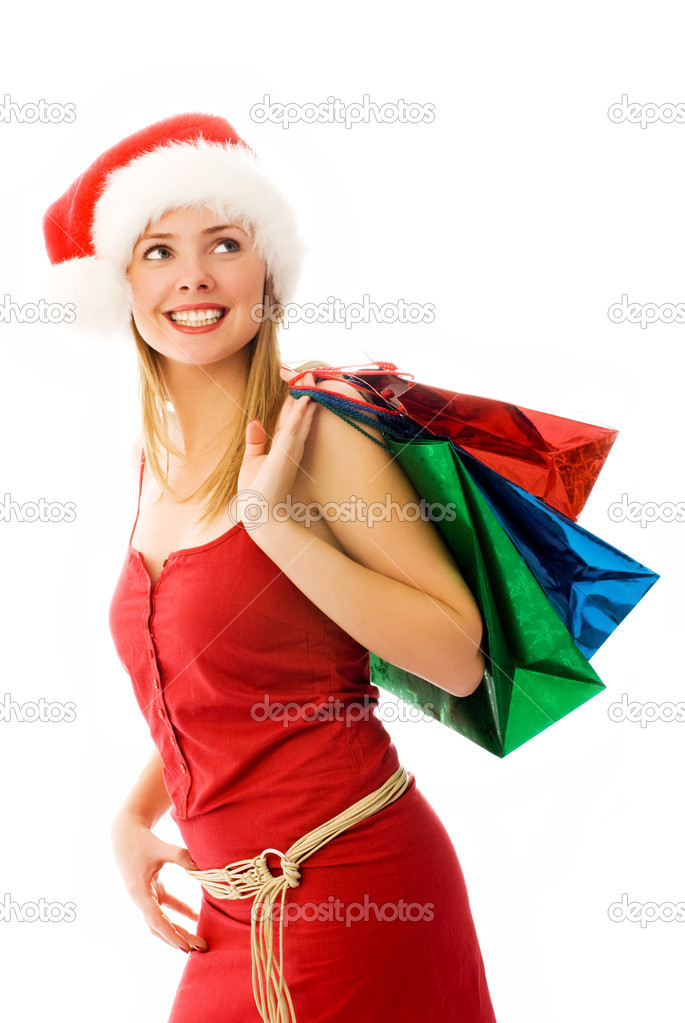 Girl wearing Santa's hat with Christmas presents — Stock Photo #3190153