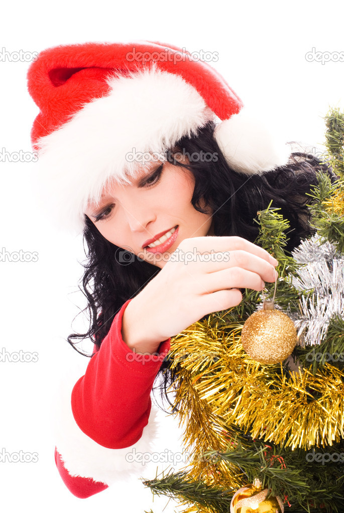 Beautiful smiling brunette woman dressed as Santa decorating a Christmas tree — Stock Photo #3191096