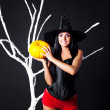 Witch with a pumpkin — Stock Photo #3759742