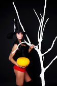 Witch with a pumpkin — Stock Photo