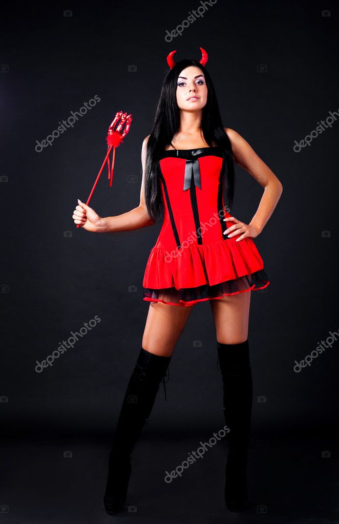 Sexy brunette girl wearing a halloween costume of an imp — Stock Photo #3759579