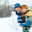 Stock Photo: Father and son go ice skating