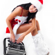 Girl dressed as Santa printing on the typewriter — Stock Photo