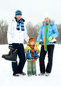 Family ice skating — Stock Photo