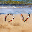 Word LOVE on beach sand — Stock Photo