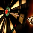 Dart board in bar - Stock Photo