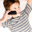 Teen boy talking on cell phone — Stock Photo #3489035