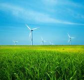 Wind turbines on green field — Stock Photo