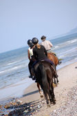 Beach horse-riding — Stock Photo