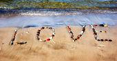 Word LOVE on beach sand — Stock Photo