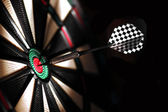 Dart board in bar — Stock Photo