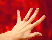 Woman hand with gold ring — Stock Photo