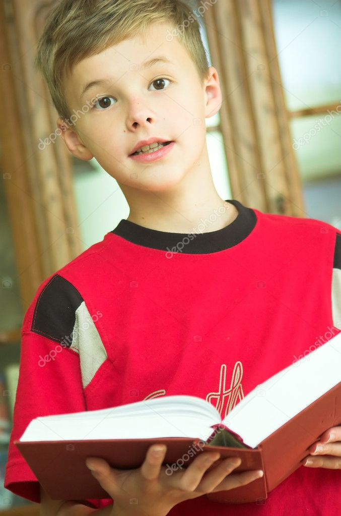 Young boy reading old, heavy book — Stock Photo #3482744
