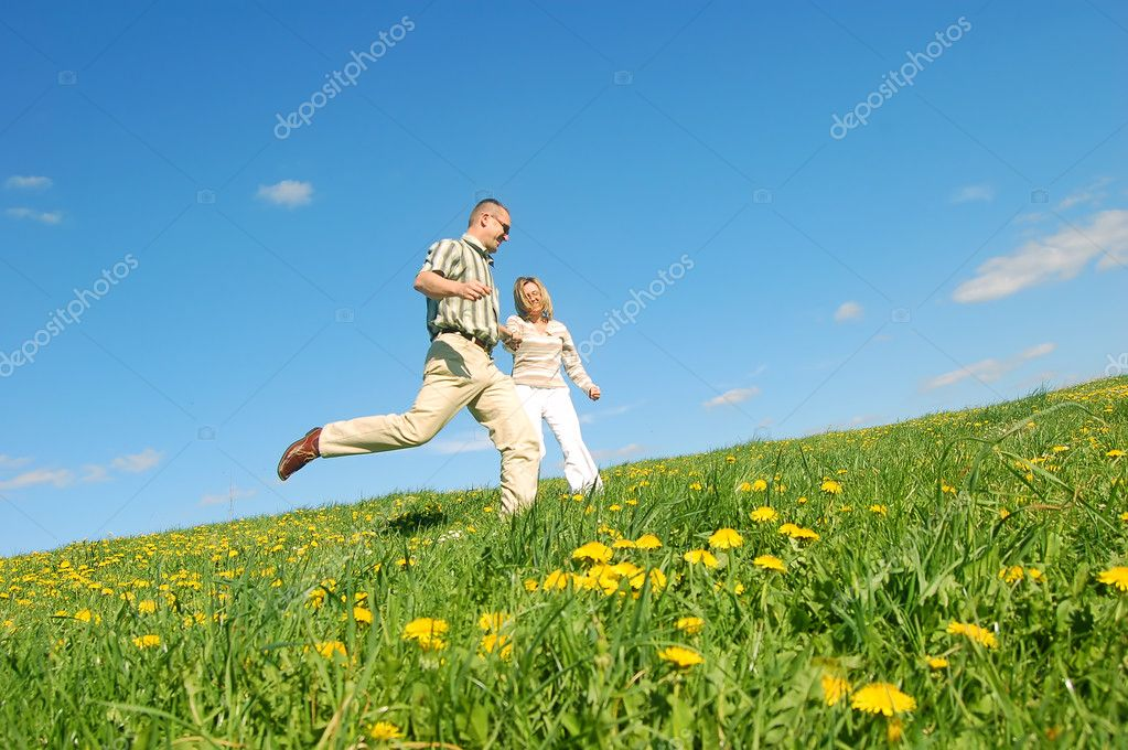Couple in love on spring meadow — Stock Photo #3490081