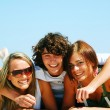 Young friends on the summer beach — Stockfoto #3500306