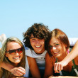 Young friends on the summer beach — Stok Fotoğraf #3500306