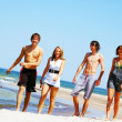 Young friends on the summer beach — Stock Photo