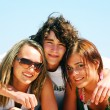 Young friends on the summer beach — Stock Photo #3500401