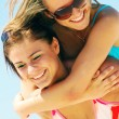 Young women on the summer beach — Stock Photo