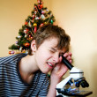 Stock Photo: Young boy with christmas present