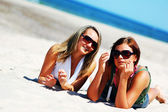 Young girls on the summer beach — Stock Photo